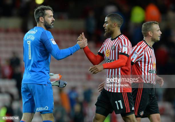 Lewis Grabban of Sunderland shakes hands with Scott Carson of Derby County during the Sky Bet Championship match between Sunderland and Derby County...