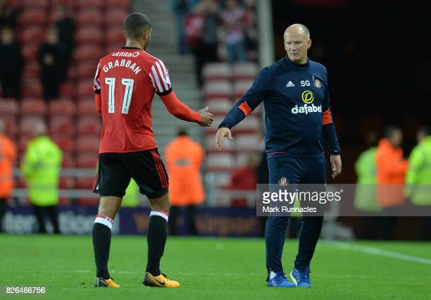 Lewis Grabban of Sunderland shakes hands with sunderland manager Simon Grayson during the Sky Bet Championship match between Sunderland and Derby...