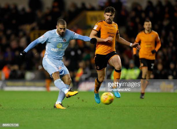 Lewis Grabban of Sunderland shoots at goal ahead of Ruben Neves of Wolverhampton Wanderers during the Sky Bet Championship match between...