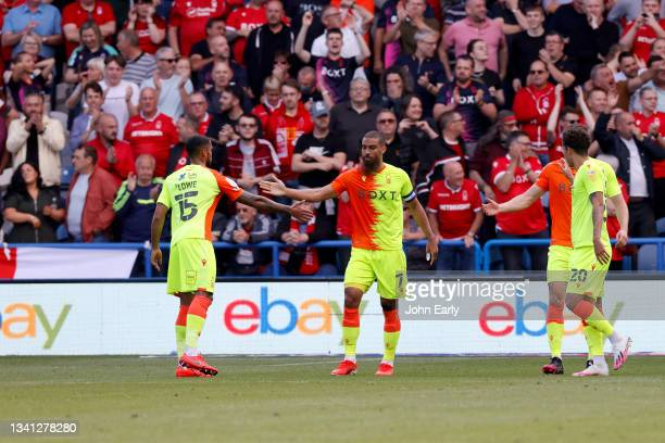 Lewis Grabben of Nottingham Forest celebrates with his team mates in front of the travelling fans after scoring during the Sky Bet Championship match...