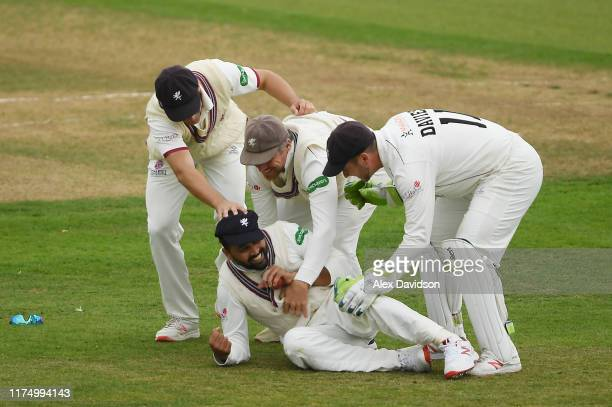 Lewis Gregory James Hildreth and Steve Davies congratulate Murali Vijay of Somerset on his catch of Ian Holland of Hampshire during Day One of The...