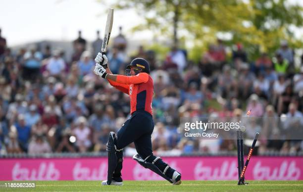 Lewis Gregory of England is bowled by Lockie Ferguson of New Zealand during game three of the Twenty20 International series between New Zealand and...