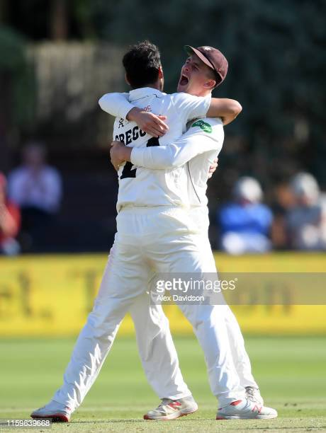 Lewis Gregory of Somerset celebrates taking the wicket of Oli Soanes of Hampshire with Tom Abell of Somerset during Day Three of the Specsavers...