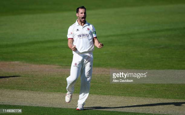 Lewis Gregory of Somerset celebrates the wicket of Dean Elgar of Surrey during Day One of the Specsavers County Championship match between Somerset...