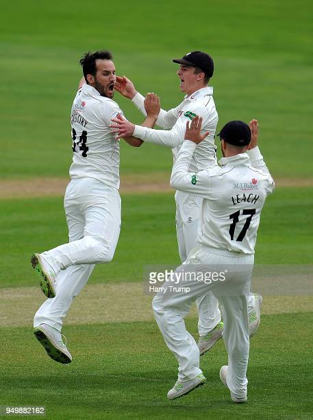 Lewis Gregory of Somerset celebrates the wicket of Joe Clarke of Worcestershire with Tom Abell and Jack Leach of Somerset during Day Three of the...