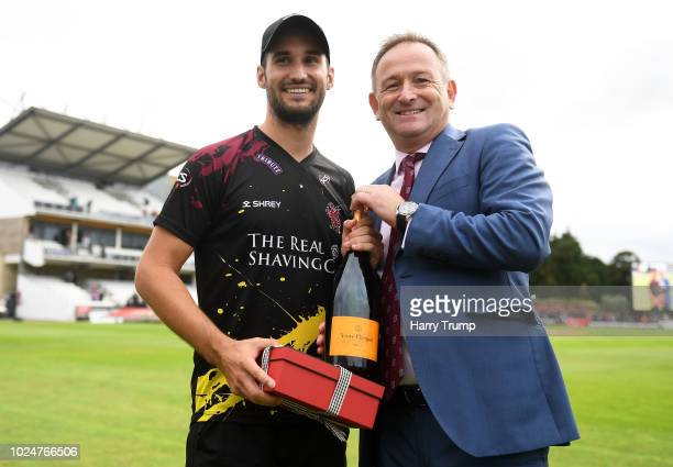 Lewis Gregory of Somerset is presented with the man of the match award by Andrew Cornish CEO of Somerset during the Vitality Blast QuarterFinal match...