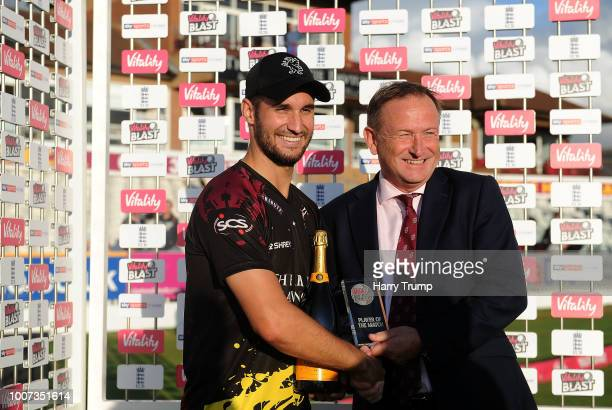 Lewis Gregory of Somerset poses with Andrew Cornish CEO of Somerset after being named player of the match during the Vitality Blast match between...