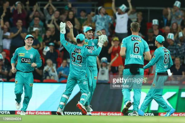 Lewis Gregory of the Heat celebrates after taking a catch during the Big Bash League match between the Brisbane Heat and the Melbourne Stars at...