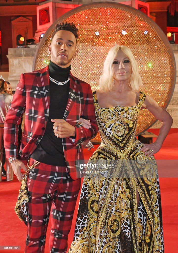 Lewis Hamilton (L) and Donatella Versace attend The Fashion Awards 2017 in partnership with Swarovski at Royal Albert Hall on December 4, 2017 in London, England.