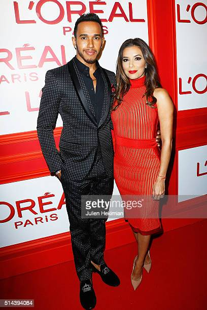 Lewis Hamilton and Eva Longoria attend the L'Oreal Red Obsession Party during Paris Fashion Week Womenswear Fall/Winter 2016/2017 on March 8 2016 in...