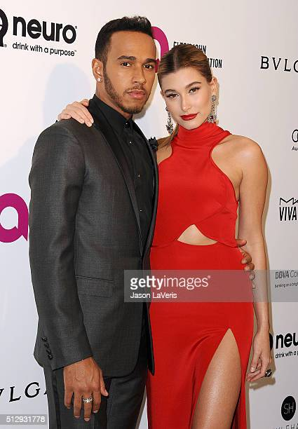 Lewis Hamilton and Hailey Rhode Baldwin attend the 24th annual Elton John AIDS Foundation's Oscar viewing party on February 28 2016 in West Hollywood...