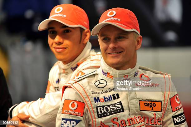 Lewis Hamilton and Heikki Kovalainen attend a photocall to launch Marks and Spencer 'Living The Dream' collection on September 17, 2009 in London,...