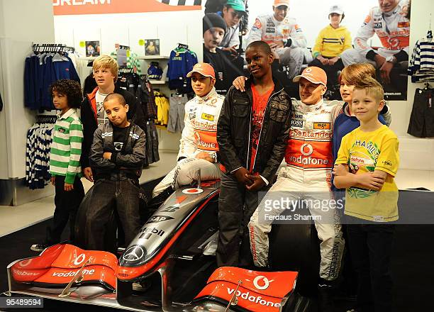Lewis Hamilton and Heikki Kovalainen attend photocall to launch Marks and Spencer 'Living The Dream' collection on September 17, 2009 in London,...