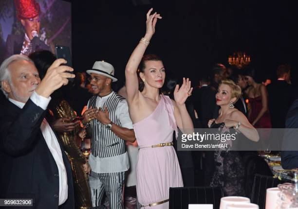 Lewis Hamilton and Milla Jovovich attend the amfAR Gala Cannes 2018 dinner at Hotel du CapEdenRoc on May 17 2018 in Cap d'Antibes France