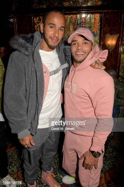 Lewis Hamilton and Nicolas Hamilton attend the TOMMYNOW after party at Annabels on February 16 2020 in London England