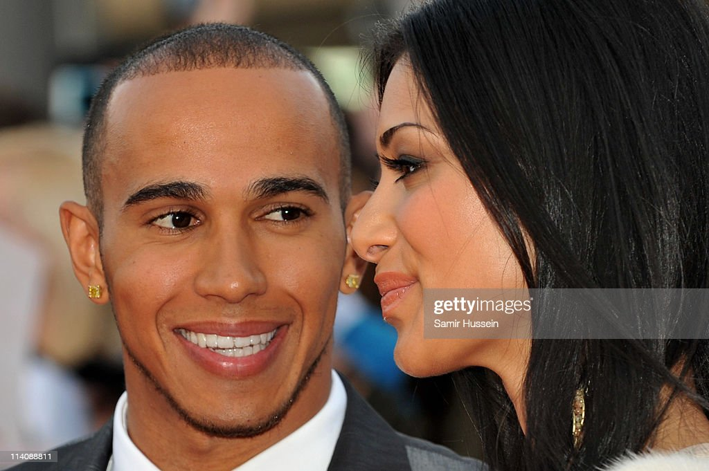Lewis Hamilton and Nicole Scherzinger arrive for The L'Oreal National Movie Awards at Wembley Arena on May 11, 2011 in London, England.