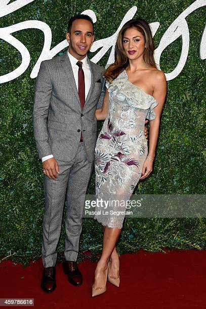 Lewis Hamilton and Nicole Scherzinger attend the British Fashion Awards at London Coliseum on December 1 2014 in London England