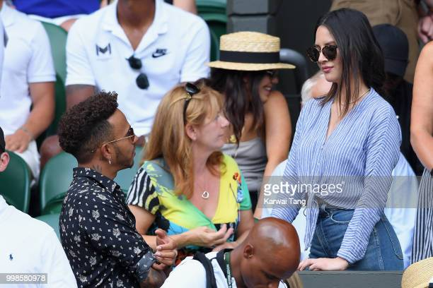Lewis Hamilton and Olivia Munn attend day twelve of the Wimbledon Tennis Championships at the All England Lawn Tennis and Croquet Club on July 13...
