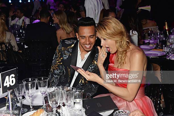 Lewis Hamilton and Petra Nemcova attend amfAR's 23rd Cinema Against AIDS Gala at Hotel du CapEdenRoc on May 19 2016 in Cap d'Antibes France