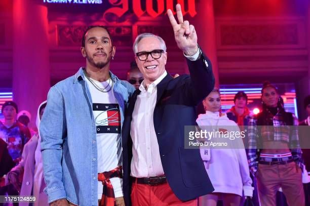 Lewis Hamilton and Tommy Hilfiger acknowledges the audience at the end of the Tommy Hilfiger presentation in Milan during the Milan Fashion Week...