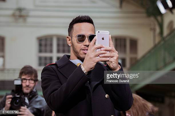 Lewis Hamilton attends the John Galliano show as part of the Paris Fashion Week Womenswear Fall/Winter 2016/2017 on March 6 2016 in Paris France