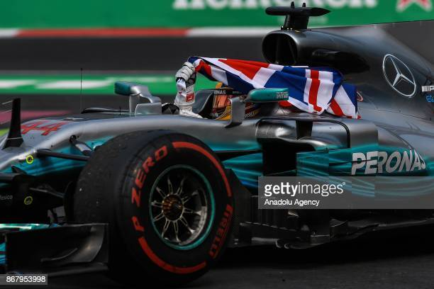 Lewis Hamilton celebrates his winning the Formula One drivers' championship after the Formula One Grand Prix of Mexico at Autodromo Hermanos...