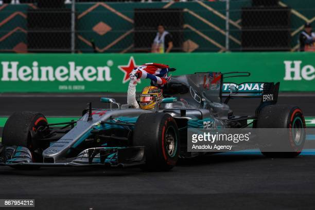 Lewis Hamilton celebrates winning the Formula One drivers' championship during the Formula One Grand Prix of Mexico at Autodromo Hermanos Rodriguez,...