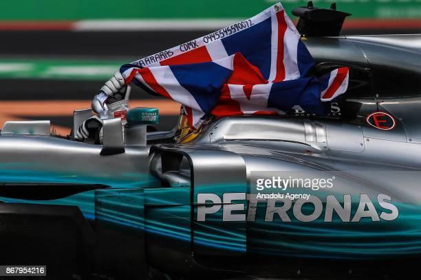 Lewis Hamilton celebrates winning the Formula One drivers' championship during the Formula One Grand Prix of Mexico at Autodromo Hermanos Rodriguez...
