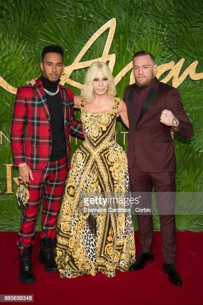 Lewis Hamilton Donatella Versace and Conor McGregor attend the Fashion Awards 2017 In Partnership With Swarovski at Royal Albert Hall on December 4...