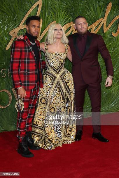 Lewis Hamilton Donatella Versace and Conor McGregor attends The Fashion Awards 2017 in partnership with Swarovski at Royal Albert Hall on December 4...