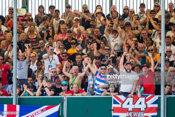 Lewis Hamilton fans celebrate Lewis Hamilton of Mercedes and Great Britain getting pole position qualifying for the Formula One Grand Prix of Great...