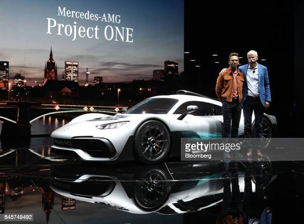 Lewis Hamilton formula one driver left and Dieter Zetsche chief executive officer of Daimler AG pose for a photograph beside a MercedesBenz AMG...