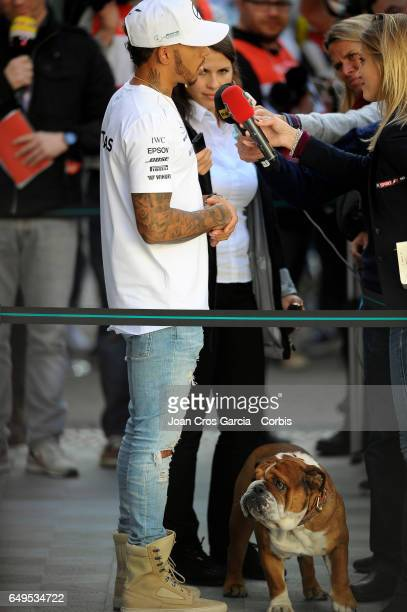 Lewis Hamilton from AMG Petronas Motorsport attending the press with his dog during the Formula One preseason tests on May 7 2017 in Barcelona Spain