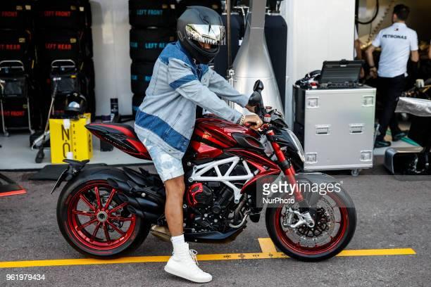 44 Lewis Hamilton from Great Britain Mercedes W09 Hybrid EQ Power team Mercedes GP with his MV Agusta motorbike during the Monaco Formula One Grand...