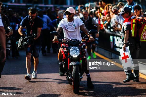 44 Lewis Hamilton from Great Britain Mercedes W09 Hybrid EQ Power team Mercedes GP portrait leaving the pitlane with his Agusta MV motorbike during...