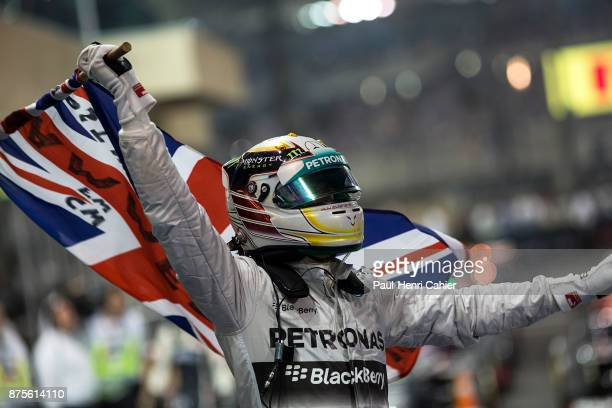 Lewis Hamilton, Grand Prix of Abu Dhabi, Yas Marina Circuit, 23 November 2014. Lewis Hamilton after the 2014 Abu Dhabi Grand Prix, celebrating his...