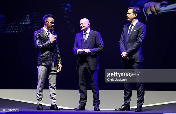 Lewis Hamilton IWC Schaffhausen CEO George Kern and Oliver Bierhoff attend the IWC Gala Dinner during the Salon International de la Haute Horlogerie...