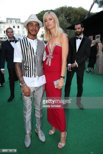 Lewis Hamilton Karolina Kurkova during the cocktail at the amfAR Gala Cannes 2018 at Hotel du CapEdenRoc on May 17 2018 in Cap d'Antibes France