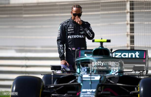 Lewis Hamilton looks around some of his competitions cars on the grid during Day One of F1 Testing at Bahrain International Circuit on March 12, 2021...