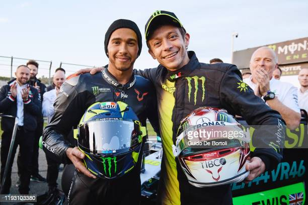 Lewis Hamilton of Great Britain and AMG Petronas F1 Team Mercedes and Valentino Rossi of Italy and Yamaha Factory Racing swapped their respective...