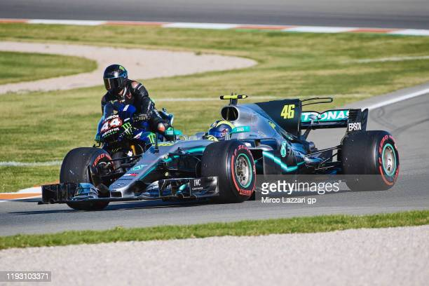 Lewis Hamilton of Great Britain and AMG Petronas F1 Team Mercedes riding the 2019 Yamaha YZR-M and Valentino Rossi of Italy and Yamaha Factory Racing...