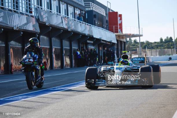 Lewis Hamilton of Great Britain and AMG Petronas F1 Team Mercedes riding the 2019 Yamaha YZR-M1 and Valentino Rossi of Italy and Yamaha Factory...