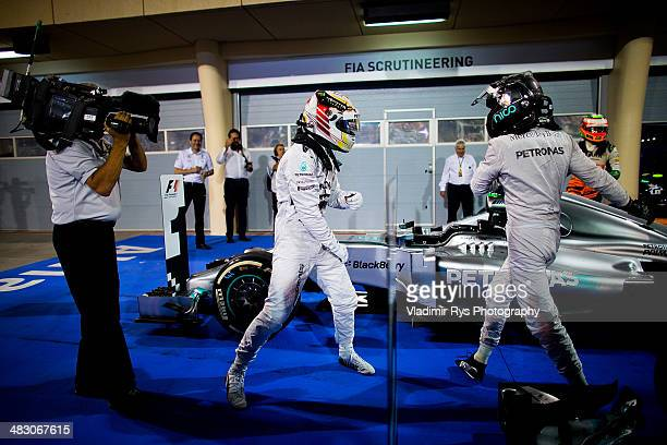 Lewis Hamilton of Great Britain and his team mate Nico Rosberg of Germany and Mercedes GP Petronas celebrate after finishing first and second during...