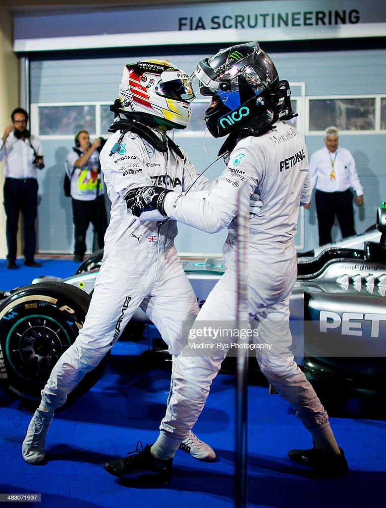 Lewis Hamilton of Great Britain (L) and his team mate Nico Rosberg of Germany and Mercedes GP Petronas celebrate after finishing first and second during the Bahrain Formula One Grand Prix at the Bahrain International Circuit on April 06, 2014 in Sakhir, Bahrain.