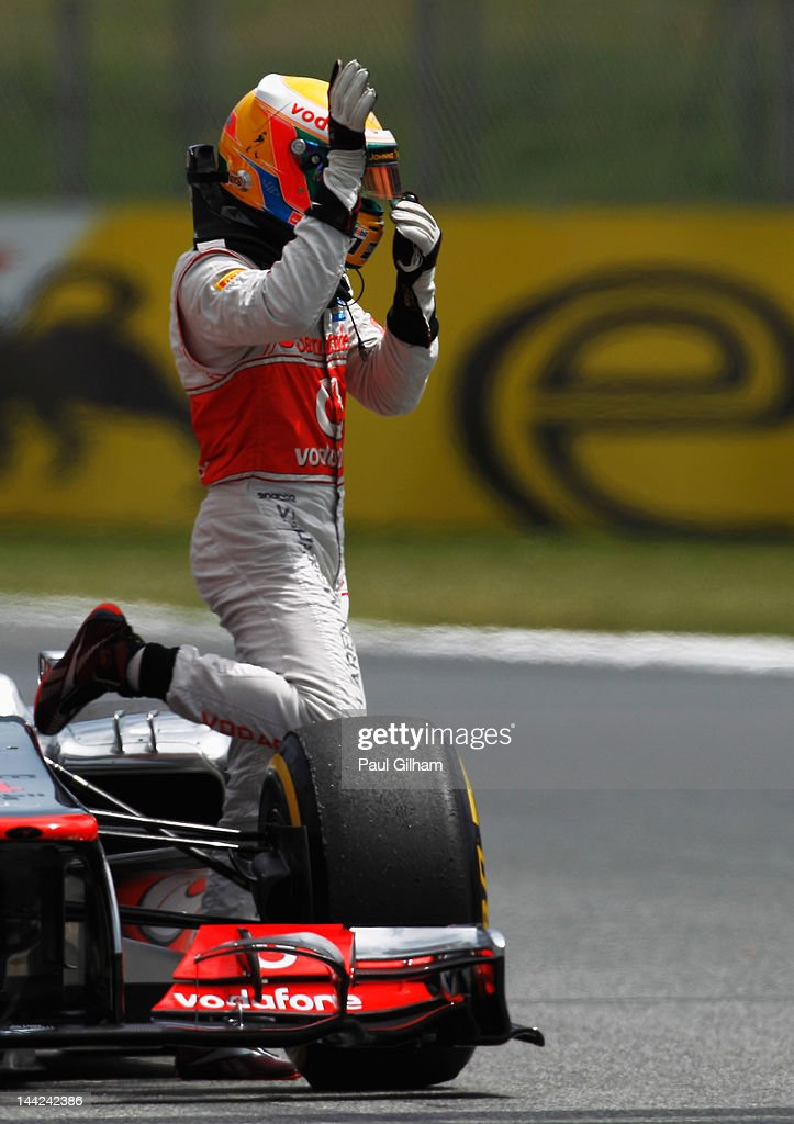 Lewis Hamilton of Great Britain and McLaren acknowledges the crowd as he stops out on the track after finishing first during qualifying for the Spanish Formula One Grand Prix at the Circuit de Catalunya on May 12, 2012 in Barcelona, Spain.