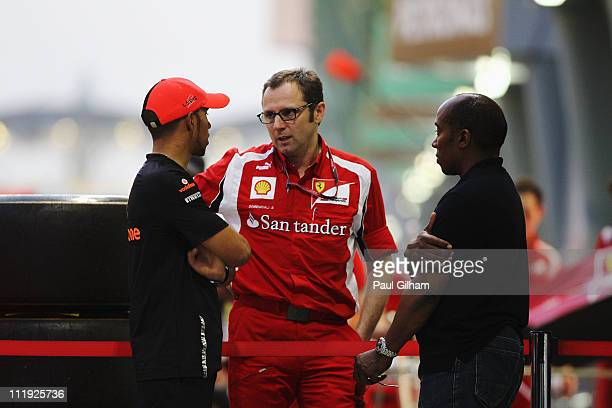 Lewis Hamilton of Great Britain and McLaren and his father Anthony Hamilton talk with Ferrari Team Principal Stefano Domenicali outside the McLaren...