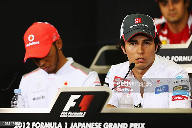 Lewis Hamilton of Great Britain and McLaren and Sergio Perez of Mexico and Sauber F1 attend the drivers press conference during previews for the...