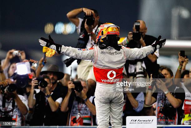 Lewis Hamilton of Great Britain and McLaren celebrates in parc ferme after winning the Abu Dhabi Formula One Grand Prix at the Yas Marina Circuit on...