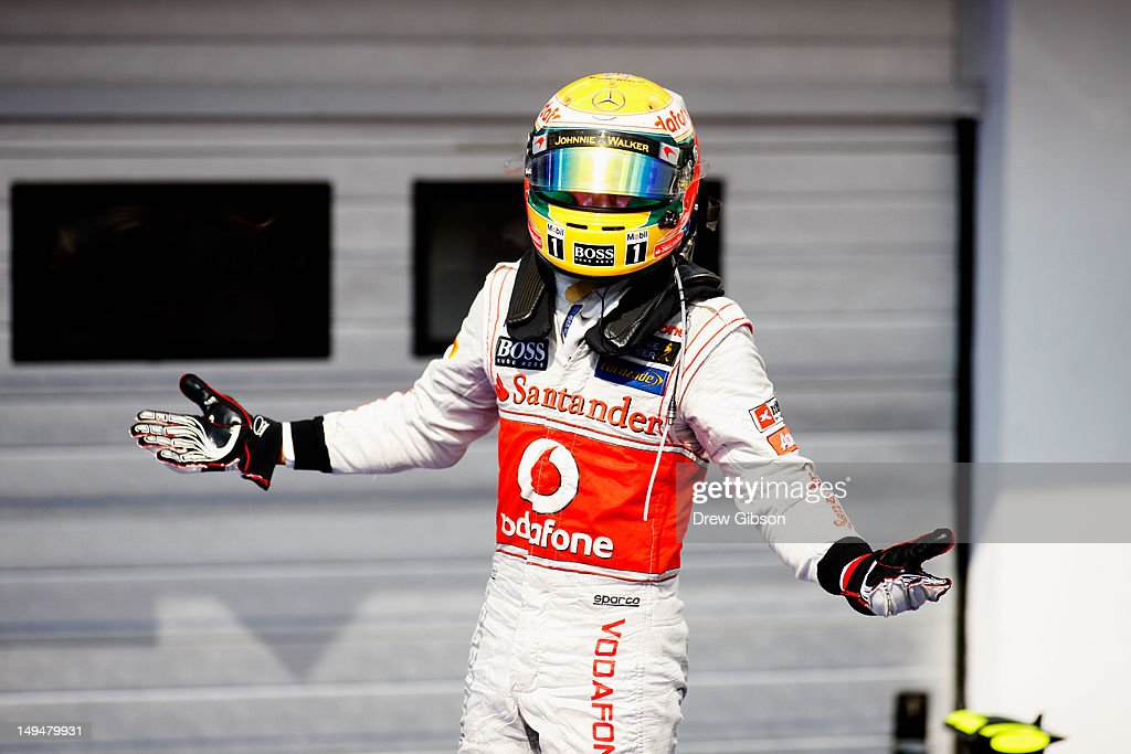 Lewis Hamilton of Great Britain and McLaren celebrates in parc ferme after finishing first during the Hungarian Formula One Grand Prix at the Hungaroring on July 29, 2012 in Budapest, Hungary.