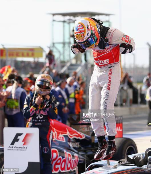 Lewis Hamilton of Great Britain and McLaren celebrates in parc ferme after winning the United States Formula One Grand Prix at the Circuit of the...